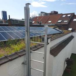JOMY retractable ladder used to climb on roof for solar panels maintenance.