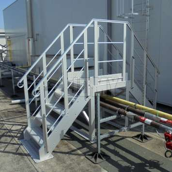 Crossover stairs used over factory piping systems.