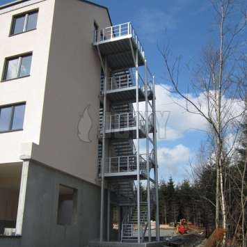 4 stories high egress stairs installed parallel to the apartment facade.