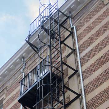 Evacuation cage ladder with custom access landing and balcony made to requirements.