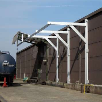 Fall protection system composed of a rail and a carriage for using a lifeline when working on top of a tanker trailer.
