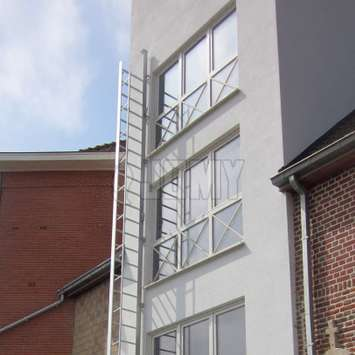 JOMY fire escape foldout ladder installed on the facade of a 3 storey building.
