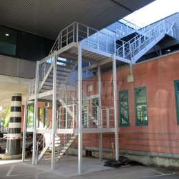 Fire escape staircase in aluminium for an office building.