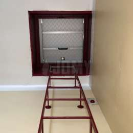 Painted ladder used to access an attic hatch.