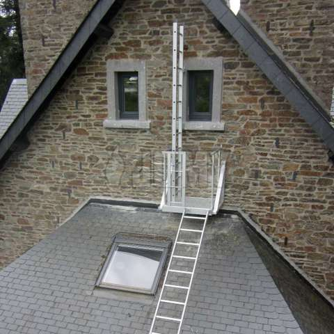 Fixed ladders on wall and roof used for fire evacuation.