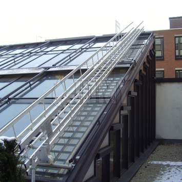 Inclined stairs with handrails for window cleaning on roof - Building Maintenance Unit