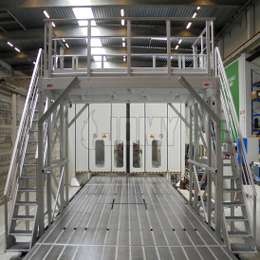 Industrial platform bridge and stairs in aluminium used on an engine production line.