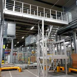 Industrial stairs and walkway platform in aluminium used to access a warehouse mezzanine.