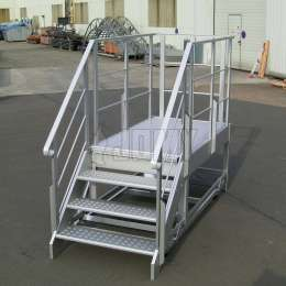 Mobile aluminium workplatform with stairs and platform.