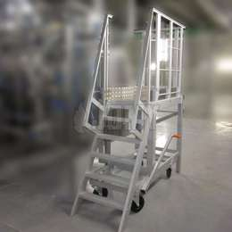 Ship ladder on wheels with a central brake system used for industrial machine access.