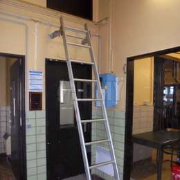 Hook ladder used to access a service door situated above a corridor door.
