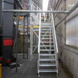 Aluminium stairs for machine access and maintenance in a factory.