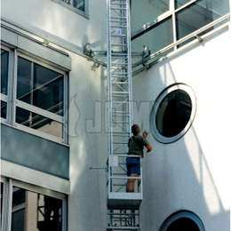 Traveling ladder and gantry for window cleaning.