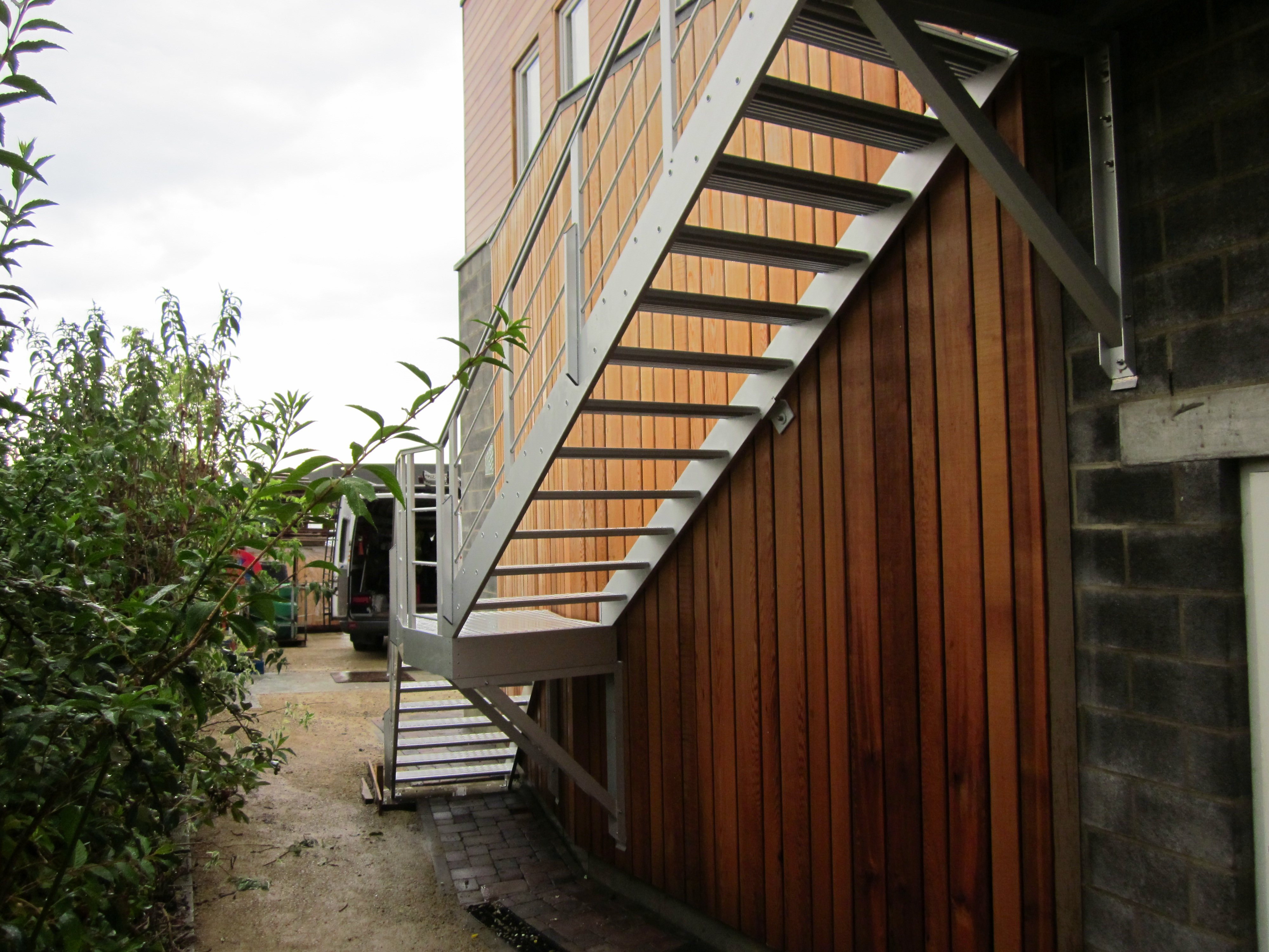 An outside aluminum staircase with clean nice architectural effect